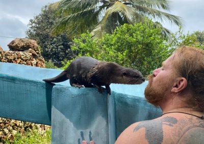 Man kissing Otter